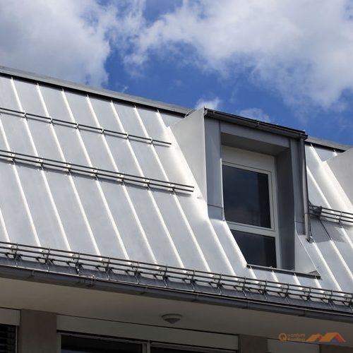 Metal Standing Seam Roof Against Blue Sky
