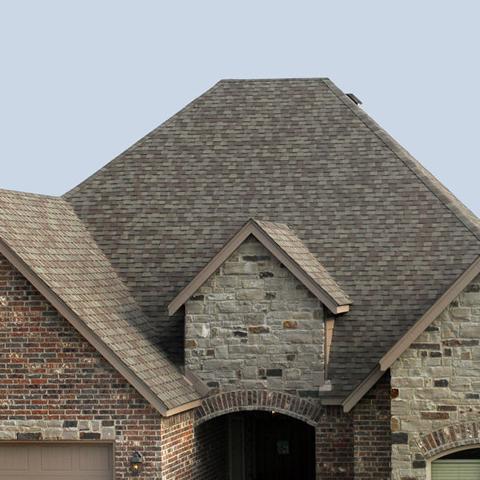shingle roof on brick house